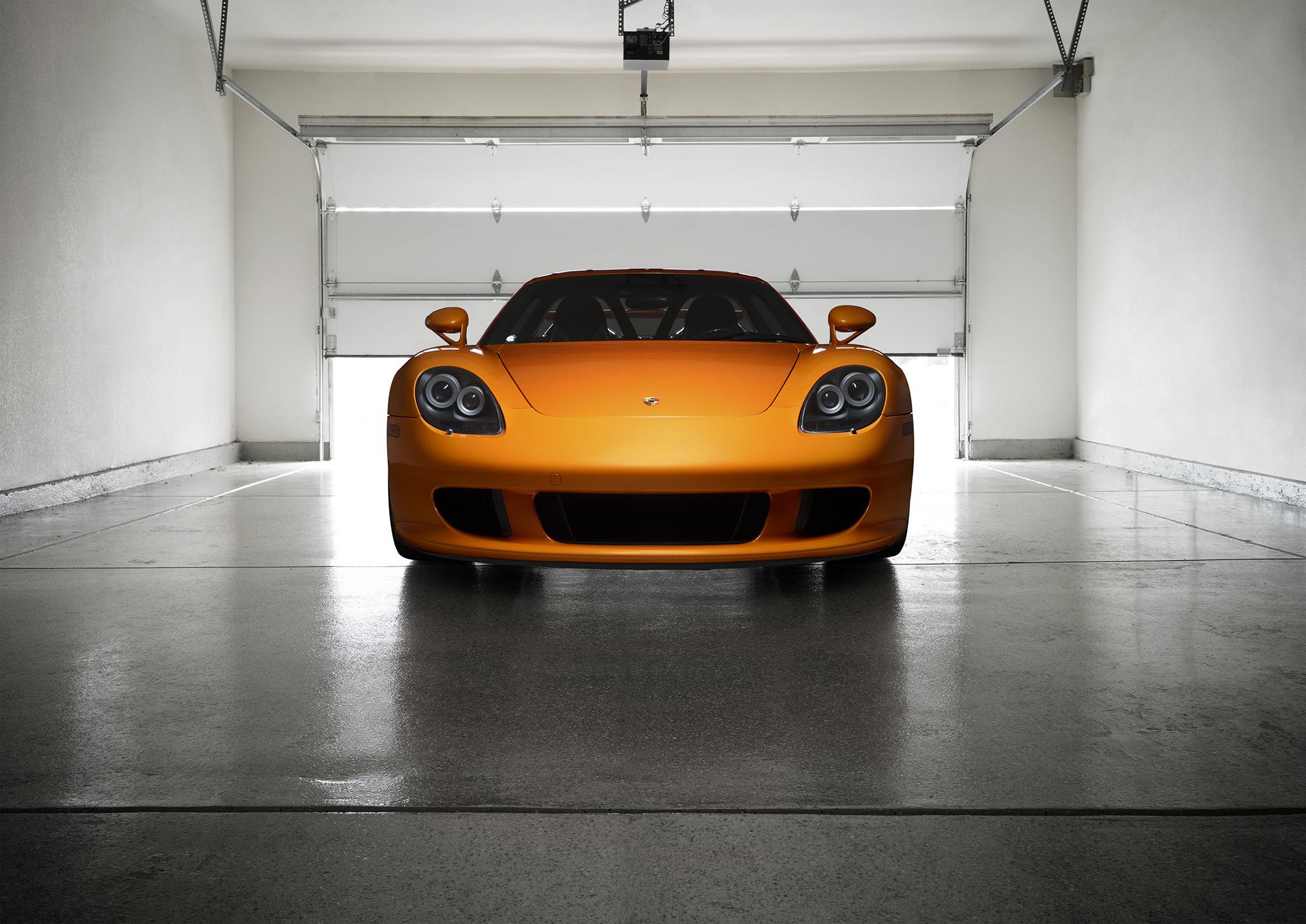 Оранжевый автомобиль porsche carrera  № 837087 загрузить