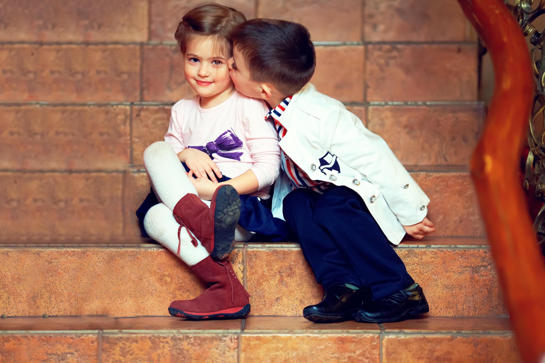 Sexy boy kisses a girl
