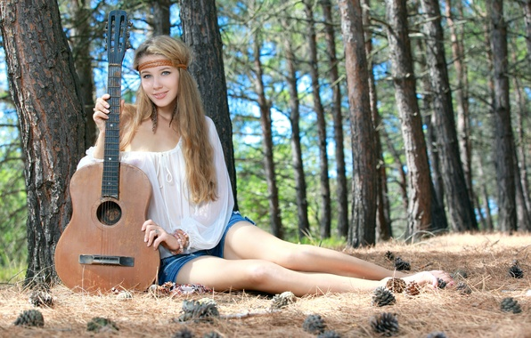 Picture forest, girl, sweetheart, model, shorts, guitar, feathers, blonde, beautiful, sitting, bumps, looks, green eyes, smiling, …