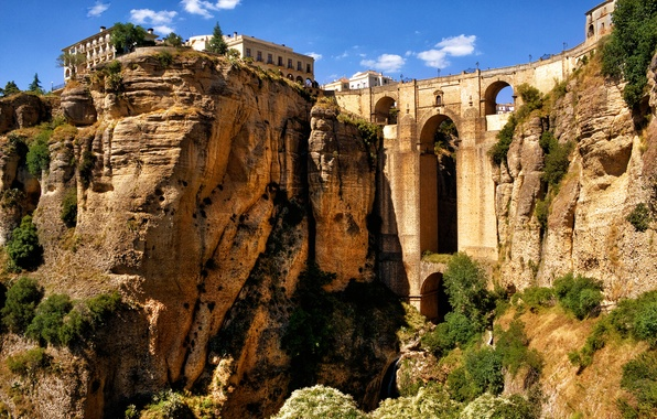 Picture the sky, mountains, bridge, rocks, home, arch, gorge, Spain, Spain, aqueduct, Andalusia, Ronda