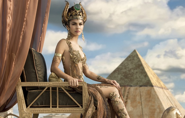 Picture the sky, clouds, decoration, chair, figure, fantasy, pyramid, outfit, curtains, Elodie Yung, Elodie Yung, The …