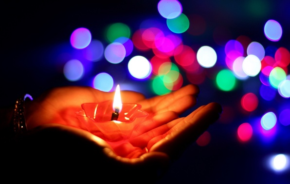Picture lights, candle, hands
