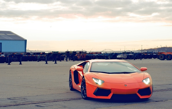 Picture the sky, clouds, orange, the building, lamborghini, front view, orange, headlights, aventador, lp700-4, Lamborghini, aventador