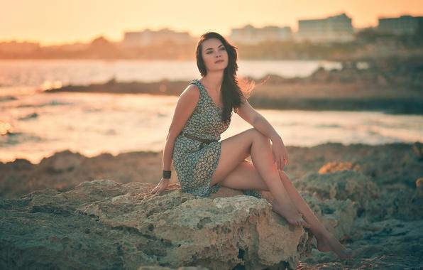 Picture look, girl, sunset, pose, stones, shore, dress, brunette, bracelet