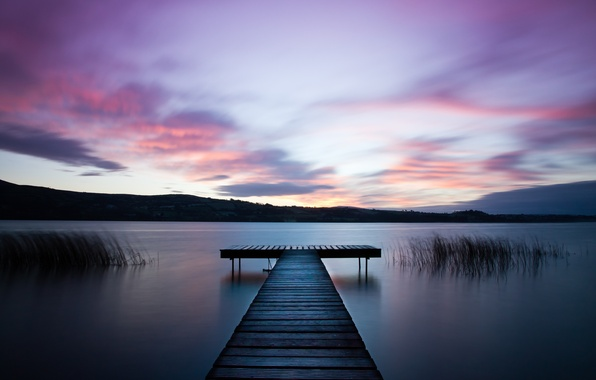 Picture the sky, grass, water, clouds, surface, river, shore, the evening, wooden, Ireland, the bridge, lilac