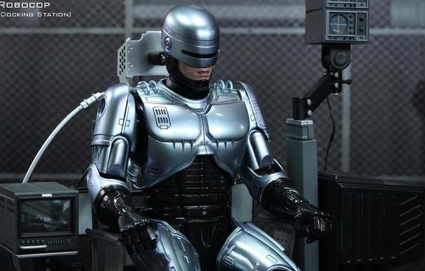 Picture robot, hero, armor, cyborg, sitting, iron, police, Robocop, charging