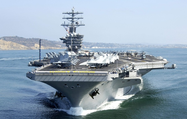 """Picture the ocean, helicopters, fighters, the carrier, deck, Multipurpose, type """"Nimitz"""", The lead ship, room CVN-68, ..."""