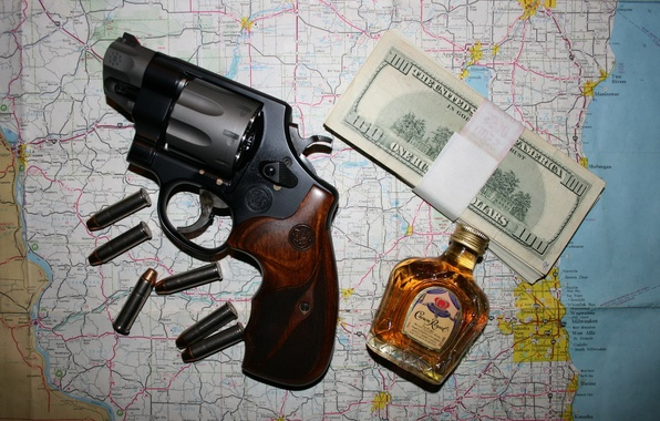 Picture money, cartridges, revolver, whiskey