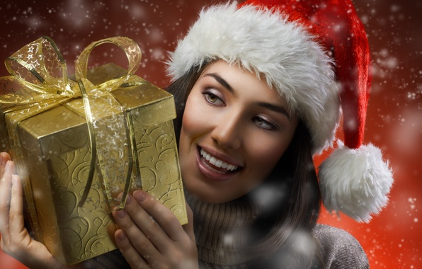 Picture girl, snow, smile, holiday, box, gift, brown hair, cap, sweater