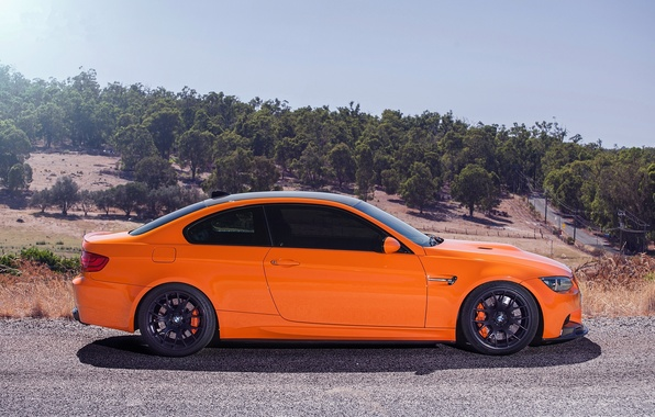 Picture the sky, trees, orange, black, bmw, BMW, slope, profile, wheels, drives, black, tuning, orange, e92