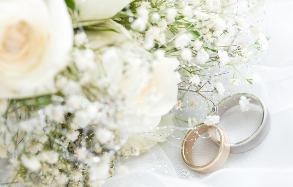 Wedding Rings With Flowers Two Wedding Rings With White Flower In
