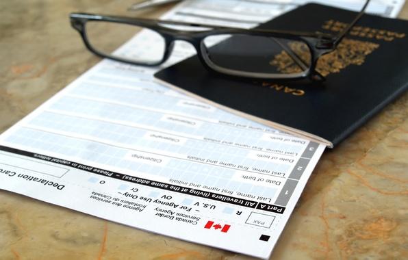 Picture form, pen, canada flag, passport