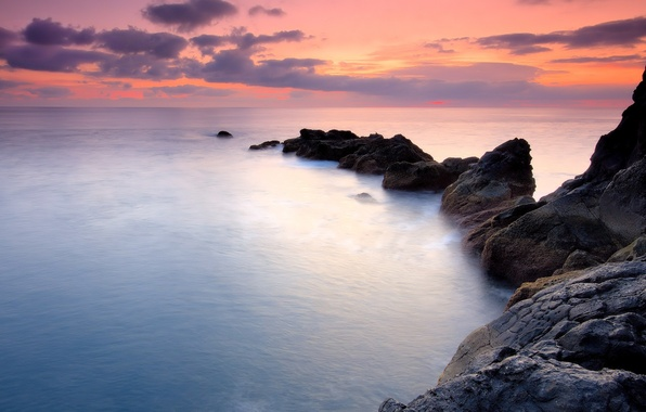 Picture the sky, water, sunset, the ocean, rocks