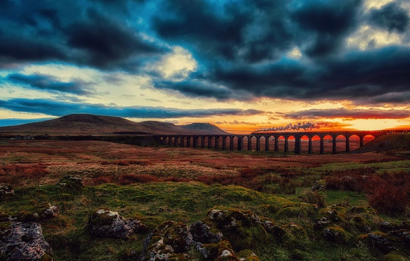 Picture the sky, clouds, sunset, clouds, bridge, train, the engine, valley, railroad