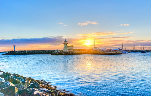 Picture sea, the sky, the sun, clouds, rays, sunset, stones, lighthouse, pierce, Ireland, they say, Dublin