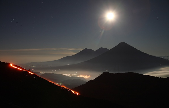 Picture the sky, stars, mountains, the city, lights, the volcano, the eruption, Guatemala