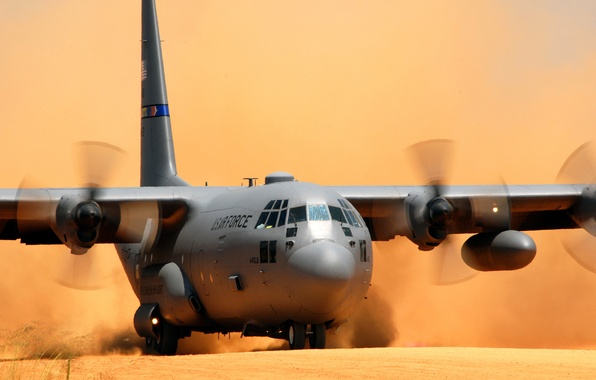 Picture the plane, dust, landing, Lockheed C-130 Hercules