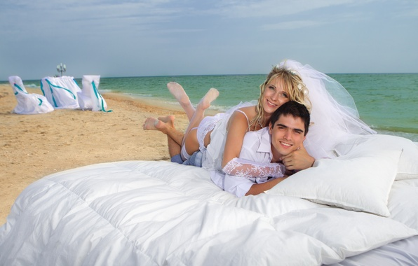 Picture sea, beach, girl, blonde, pair, bed, pillow, guy, the bride, the groom, smile. veil