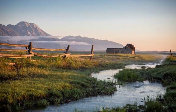 Picture the sky, grass, sunset, mountains, fog, house, stream, the fence