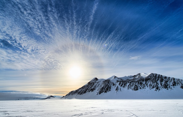 Picture the sky, the sun, clouds, snow, mountains, Antarctica