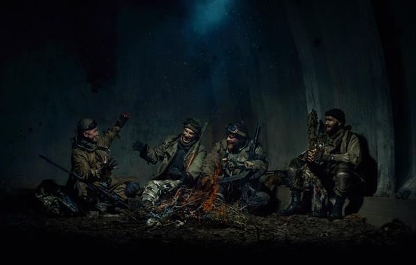 Picture men, stalkers, campfire