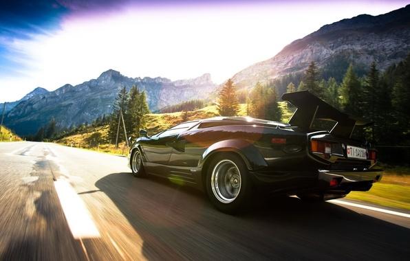 Picture road, the sky, the sun, clouds, light, trees, mountains, rocks, speed, Lamborghini, Blik, Lamborghini, the …