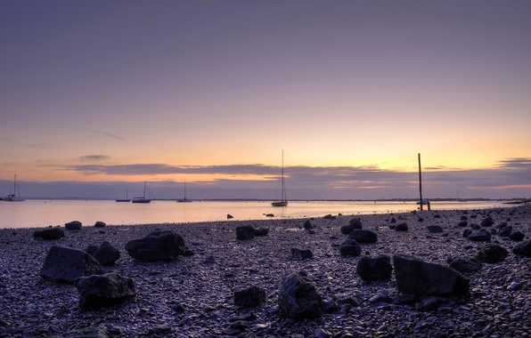 Picture the sky, water, sunset, stones, the ocean, shore, boats