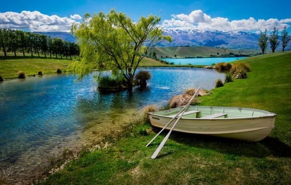 Picture the sky, clouds, lake, pond, tree, boat, cascade