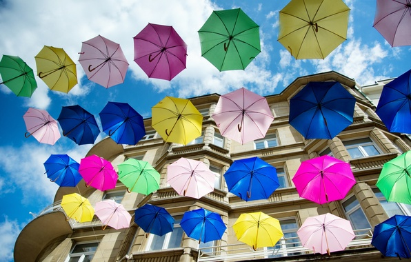Picture the city, house, umbrellas