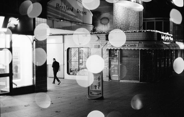 Picture light, night, man, shop, globes, urban scene