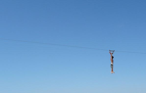 Picture the sky, boy, zipline