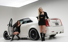 Picture Girls, blonde and brunette, two beautiful girls, cadillac cts 2008, brunette in the cabin, near …
