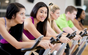 Picture women, workout, fitness, gym, stationary bicycle