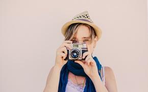 Picture girl, hat, camera, scarf, diretc gaze