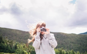 Picture girl, the camera, photographs, relieves