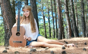 Picture forest, girl, sweetheart, model, shorts, guitar, feathers, blonde, beautiful, sitting, bumps, looks, green eyes, smiling, ...