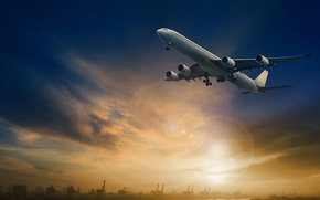 Picture the sky, the sun, landscape, glare, the plane, river, glow, docks, is, in the sky, ...