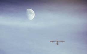 Picture the sky, flight, the moon, tricycle, hang gliding, to the moon