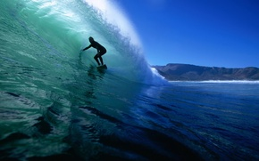 Picture the ocean, wave, surfer