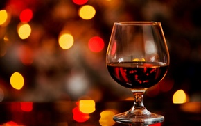 Picture glass, alcohol, cognac, bokeh