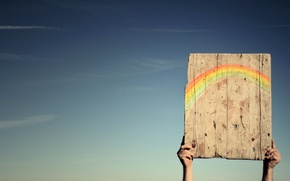 Picture the sky, rainbow, hands