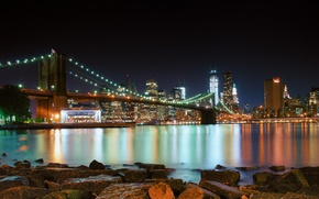 Picture water, light, night, bridge, the city, lights, stones, shore, building, the evening