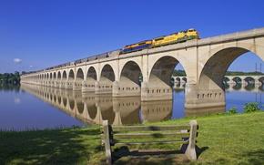 Picture the sky, trees, bridge, river, train, locomotive