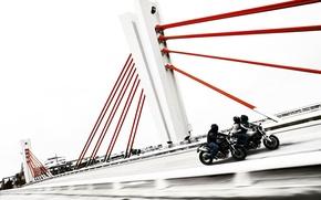 Picture bridge, ducati, motorcyclists