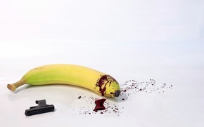 Picture gun, banana, a pool of blood, Suicide