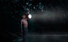 Picture boy, lantern, in the water