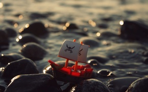 Picture sea, wave, water, stones, toy, ship, Roger, pirate, fun