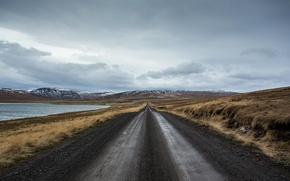 Picture road, field, mountains, lake, storm, gray clouds