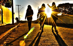 Picture the sun, light, sunset, girls, street, the rays of the sun