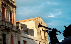 Picture the city, home, hat, silhouette, trumpeter